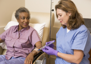 caregiver putting dextrose to an elderly patient