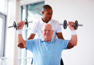 physical therapist doing therapy treatment to an elderly
